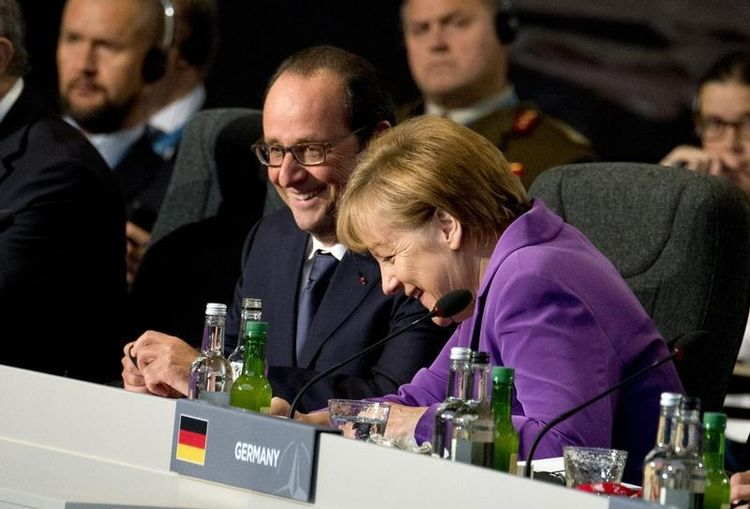675974-france-s-president-francois-hollande-talks-with-germany-s-chancellor-angela-merkel-at-a-meeting-on-t