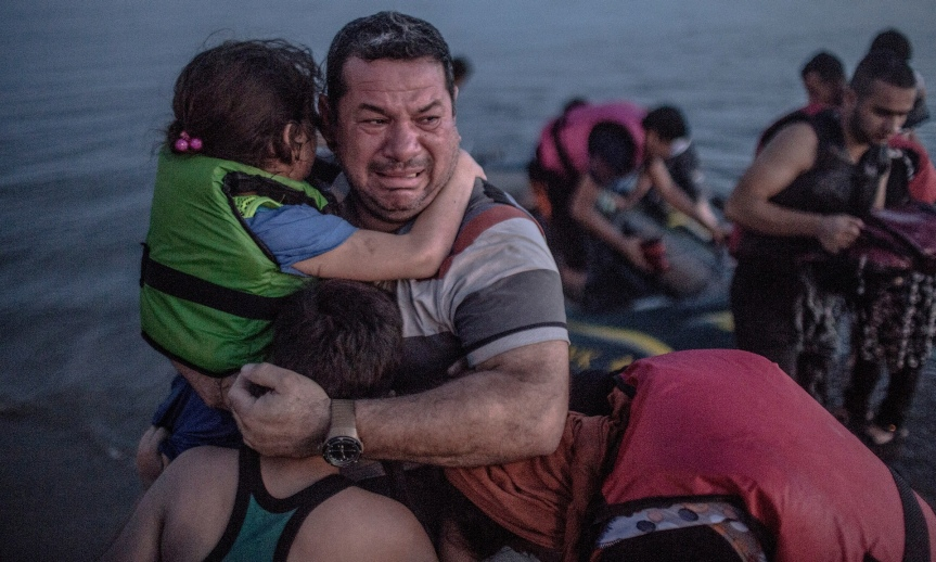 Syrian man pictured crying as his family landed in Greece finds refuge in Germany